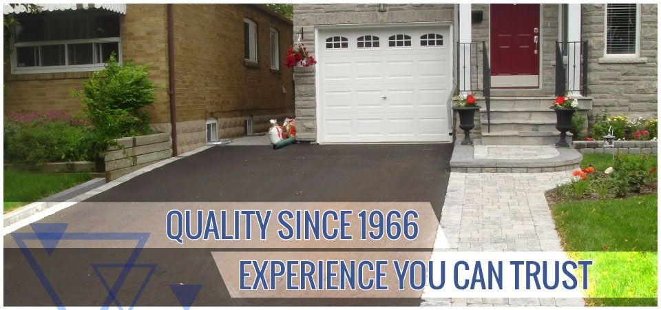 Quality since 1966. Experience you can trust. | Residential driveway with interlocking sidewalk
