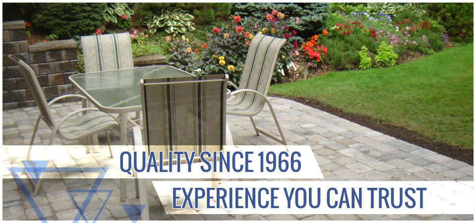 Quality since 1966. Experience you can trust. | Residential interlocking path in backyard