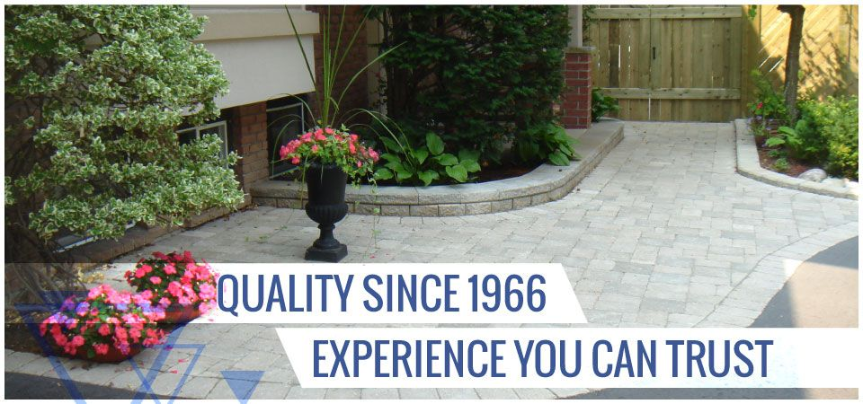 Quality since 1966. Experience you can trust. | Interlocking path in backyard