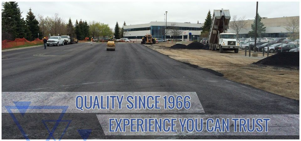 Quality since 1966. Experience you can trust. | paving a road